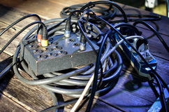 Cables on stage during concert. Cable coil and plugged cannon cables on stage during concert Royalty Free Stock Photo