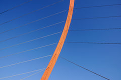Cables and tower of the suspension bridge.  Royalty Free Stock Photo