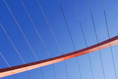 Cables and tower of the suspension bridge.  Stock Photos