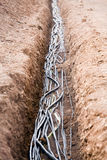 Cables in trench Stock Photo