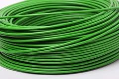 Cables verdes eléctricos Fotografía de archivo libre de regalías