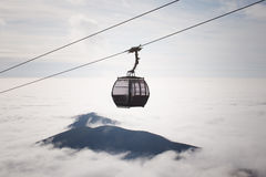 Cableway above the clouds Stock Photo