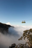 Cableway above Clouds Royalty Free Stock Photos
