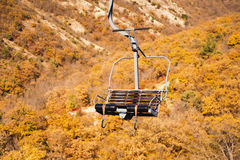 Cableway in autumn mountains Royalty Free Stock Photos
