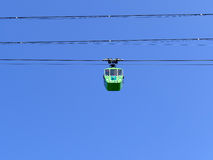 Cableway with blue sky, 1 cabin Royalty Free Stock Photo