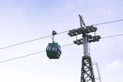 Cableway with a blue sky. A cable car hanging with a blue sky as background Stock Image