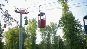 Cableway with cabins on blue sky background, Vinpearl Amusement Park stock footage