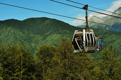 Cableway carrying bicycle. The cableway is carrying a bicycle among the mountains in summer royalty free stock photos