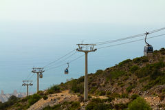 Cableway of city near sea Stock Image