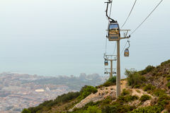 Cableway of city near sea stock photo