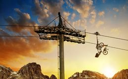 Cableway with downhill bike at colorful sunset sky. royalty free stock image