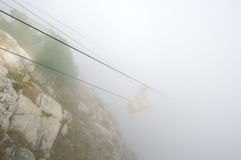 Cableway in fog Stock Photography