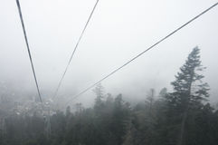 Cableway in fog Stock Image