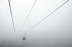 Cableway in fog Stock Images