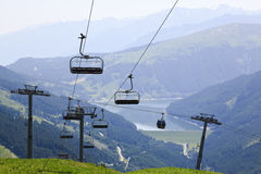 Cableway gondolas from Isskogel, Austria. In winter the Krummbach X-Press, a ski chairlift brings skiers to the ski piste in Austrian Tyrol and in summer the Royalty Free Stock Photo