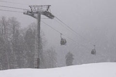 Cableway at heavy snowing weather Royalty Free Stock Photo