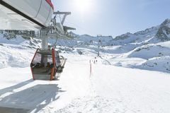 Cableway lift cable cars, gondola cabins on winter snowy mountai. Ns background beautiful scenery Stock Photography