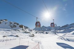 Cableway lift cable cars, gondola cabins on winter snowy mountai. Ns background beautiful scenery Stock Images