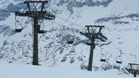 Cableway lifting few tourists to skiing run, tourism crisis, abandoned resort