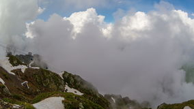Cableway in mountains against the clouds sky stock video footage