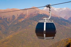 Cableway on mountains background in autumn season Stock Images