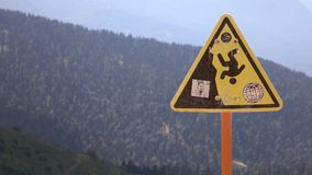 Cableway in the mountains. A sign of danger in the mountains Stock Photography