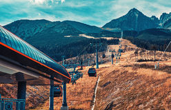 Cableway in mountains Stock Images