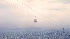 Barcelona vintage cableway. Cableway moving on top of skyline of Barcelona city from the Montjuic Castle, an old military fortress of Catalonia region stock footage