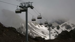 Cableway with open seats in mountains stock footage