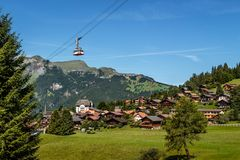 Cableway over Wengen, Switzerland. Aerial cableway over car free mountain village Wengen in the Bernese Alps on a sunny day in summer. Wengen, Bernese Oberland Stock Image