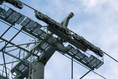 Cableway pylon against cloudy sky Royalty Free Stock Photos