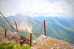 Cableway rusty and out of a quarry on the Apuan Alps. In the background a view of the valley from a height of 1180 meters Royalty Free Stock Image