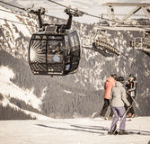 Cableway and skiers Royalty Free Stock Image