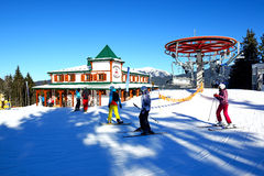 The cableway, skiers and restaurant in Bukovel Royalty Free Stock Images