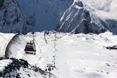 Skilift in the snowy mountains of the Caucasus stock photos