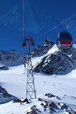Cableway to the top of a iceberg. Above the ski slopes Royalty Free Stock Images