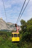 Cableway with tourists rises to the top of AI-Petri. The worlds longest unprotected span. Mishor, Yalta, Crimea, Russia - September 14, 2018: Cableway with royalty free stock image