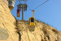 Cableway with two, yellow and red, cabins Stock Photography