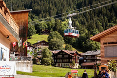 Cableway Wengen Mannlichen, Switzerland. Wengen, Bernese Oberland, Switzerland - JULY 31, 2017 : Wengen Mannlichen Aerial Cableway leaving basestation in Wengen Royalty Free Stock Photos