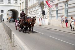 Cabman on the street of Vienna Stock Images