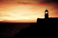 Cabo圣维森特,日落的葡萄牙灯塔  免版税库存照片