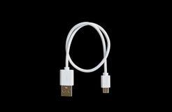 Cabo branco de USB no fundo preto Fotos de Stock Royalty Free