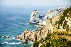 Cabo da roca. (Cape Roca) is a cape which forms the westernmost extent of mainland Portugal and continental Europe. The cape is in the Portuguese municipality Stock Photography