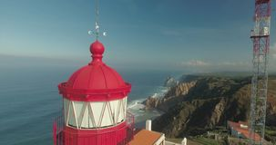 Cabo Da Roca Light House Aerial Video. Epic aerial footage of lighthouse standing on the edge of the cliff, Cape Roca, Portugal. Western point of Europe stock footage
