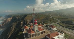 Cabo Da Roca Light House Aerial Video. Epic aerial footage of lighthouse standing on the edge of the cliff, Cape Roca, Portugal. Western point of Europe stock video