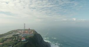 Cabo Da Roca Light House Aerial Video. Epic aerial footage of lighthouse standing on the edge of the cliff, Cape Roca, Portugal. Western point of Europe stock video footage