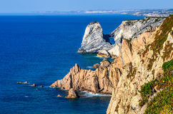 Cabo da Roca, Portugal. Portugal. Cabo da Roca and the lighthouse over Atlantic Ocean, the most westerly point of the European mainland Royalty Free Stock Photo
