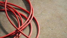 Cabo de fio da energia elétrica de cor vermelha imagens de stock royalty free