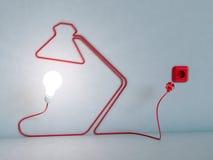 Cabo elétrico dado forma de lâmpada de mesa foto de stock royalty free