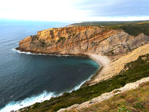 Cabo Espichel in Portugal. A view of the cliff with dinosaur fossil trackways Stock Photos